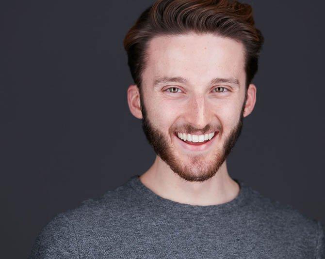 Modern Male Actor Headshot Grey Background